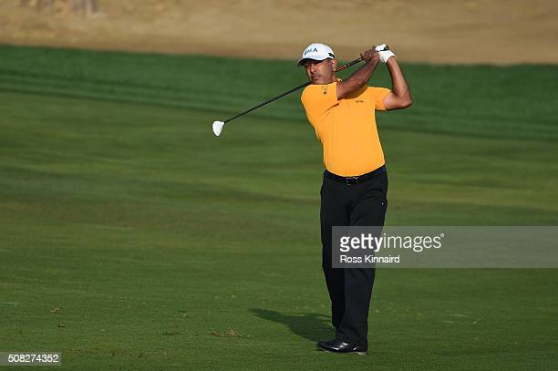Jeev Mikha Singh of India plays his second shot on the third hole during the first round of the Omega Dubai Desert Classic at The Emirates Golf Club...