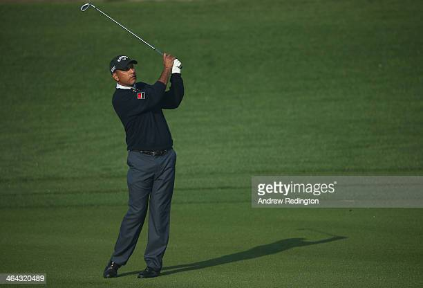 Jeev Milka Singh of India plays his second shot on the 12th hole during the first round of the Commercial Bank Qatar Masters at Doha Golf Club on...