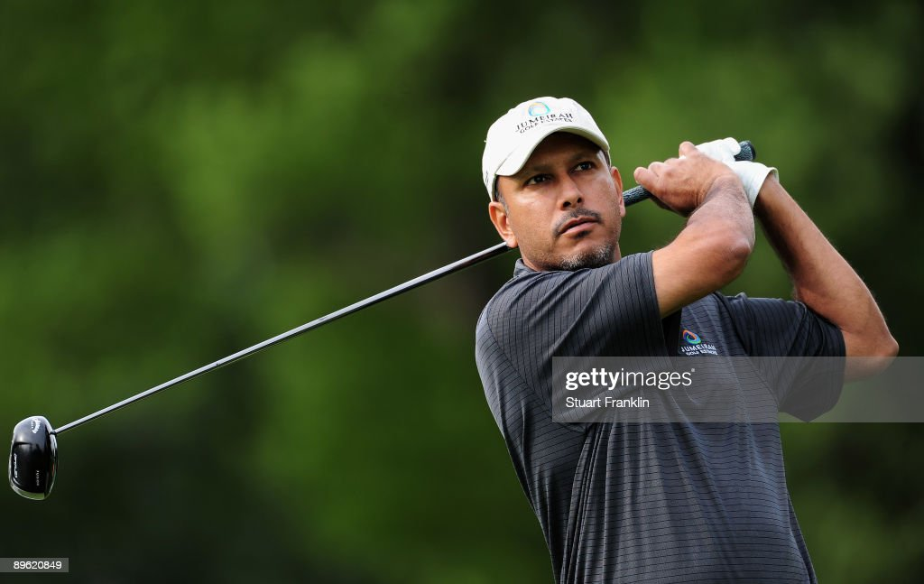 Jeev Milka Singh of India plays his tee shot during a practice round of the World Golf Championship Bridgestone Invitational on August 5, 2009 at Firestone Country Club in Akron, Ohio.