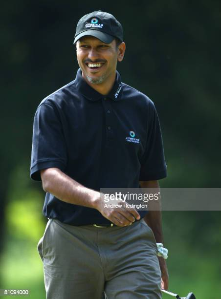 Jeev Milka Singh of India smiles after holing a long par putt on the ninth hole during the first round of the Irish Open on May 15 2008 at the Adare...
