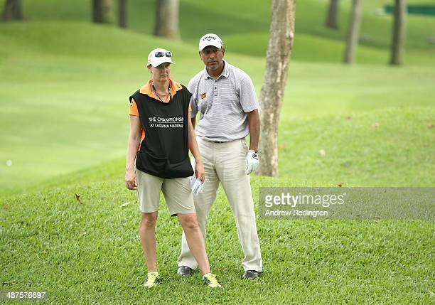 Jeev Milka Singh of India stands with his caddie Janet Squire on the tenth hole on day one of The Championship at Laguna National held at Laguna...