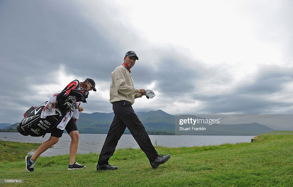 <a gi-track='captionPersonalityLinkClicked' href=/galleries/search?phrase=Jeev+Milkha+Singh&family=editorial&specificpeople=562393 ng-click='$event.stopPropagation()'>Jeev Milkha Singh</a> of India and caddie Janet Berry walk on the fourth hole during the third round of the Discover Ireland Irish Open at the Killarney golf and fishing club on July 30, 2011 in Killarney, Ireland.