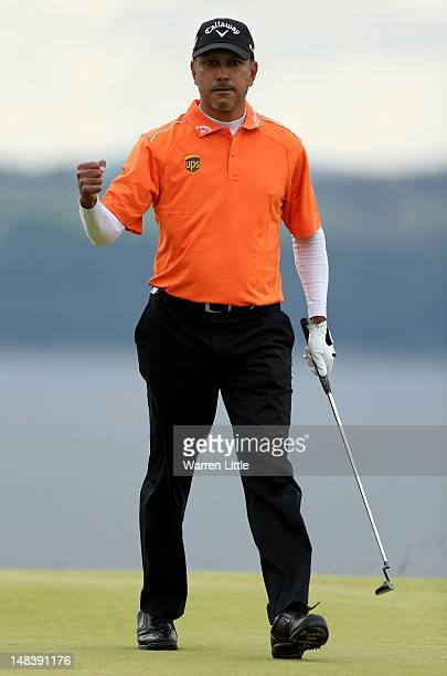 Jeev Milkha Singh of India celebrates holing a putt during a playoff against Francesco Molinari of Italy to win on the 18th green during the final...