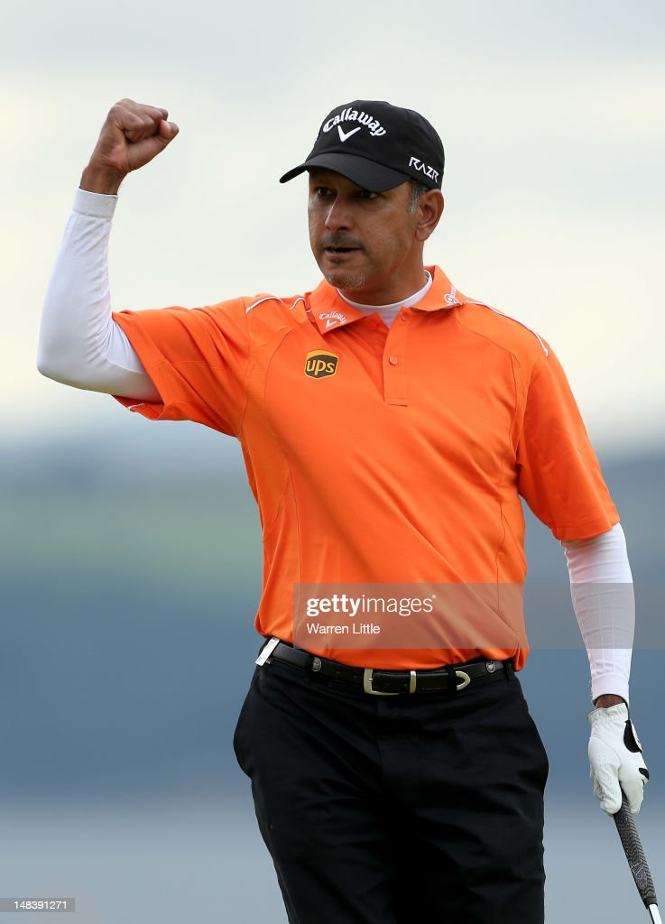 <a gi-track='captionPersonalityLinkClicked' href=/galleries/search?phrase=Jeev+Milkha+Singh&family=editorial&specificpeople=562393 ng-click='$event.stopPropagation()'>Jeev Milkha Singh</a> of India celebrates holing a putt during a playoff against Francesco Molinari of Italy to win on the 18th green during the final round of the Aberdeen Asset Management Scottish Open at Castle Stuart Golf Links on July 15, 2012 in Inverness, Scotland.