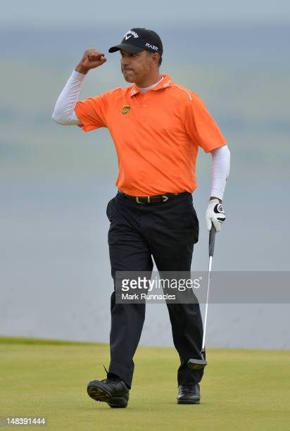 Jeev Milkha Singh of India celebrates holing a putt for victory during a playoff against Francesco Molinari of Italy on the 18th green during the...