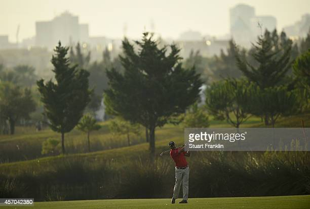 Jeev Milkha Singh of India plays a shot during the continuation of the delayed second round of the Portugal Masters at Oceanico Victoria Golf Club on...