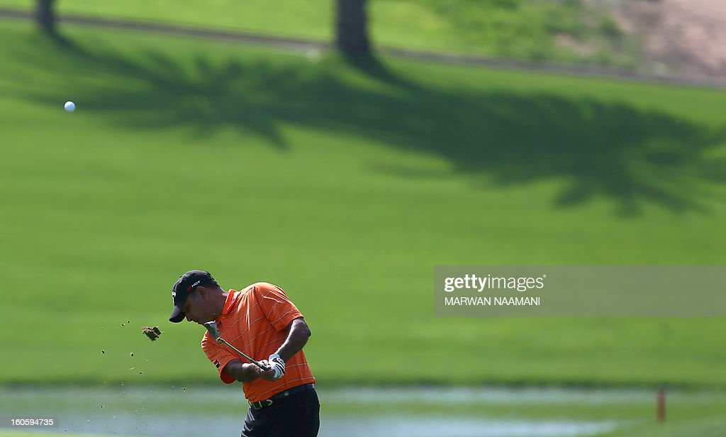 Jeev Milkha Singh of India plays a shot on the fourth and last round of the Omega Dubai Desert Classic in Dubai, on February 3, 2013. Stephen Gallacher of Scotland fired a timely eagle two on the par-4 16th hole and comfortably won the $2.5 million Omega Dubai Desert Classic in the end by three shots.