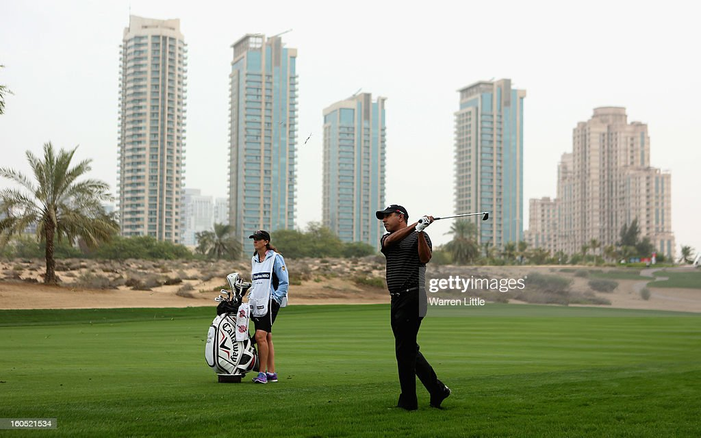 Jeev Milkha Singh of India plays his second shot into the eighth green during the third round of the Omega Dubai Desert Classic at Emirates Golf Club on February 2, 2013 in Dubai, United Arab Emirates.