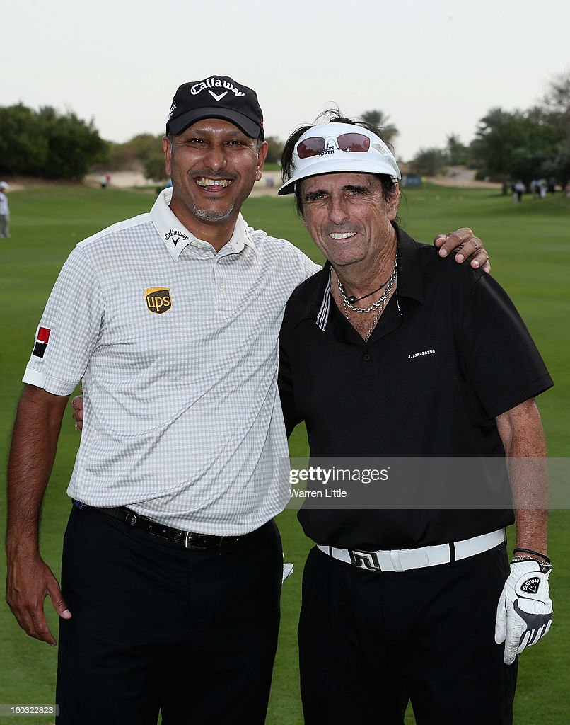 Jeev Milkha Singh of India poses with Rock Star, Alice Cooper during the Challenge Match at Jebel Ali Golf Resort as a preview for the Omega Dubai Desert Classic on January 29, 2013 in Dubai, United Arab Emirates.