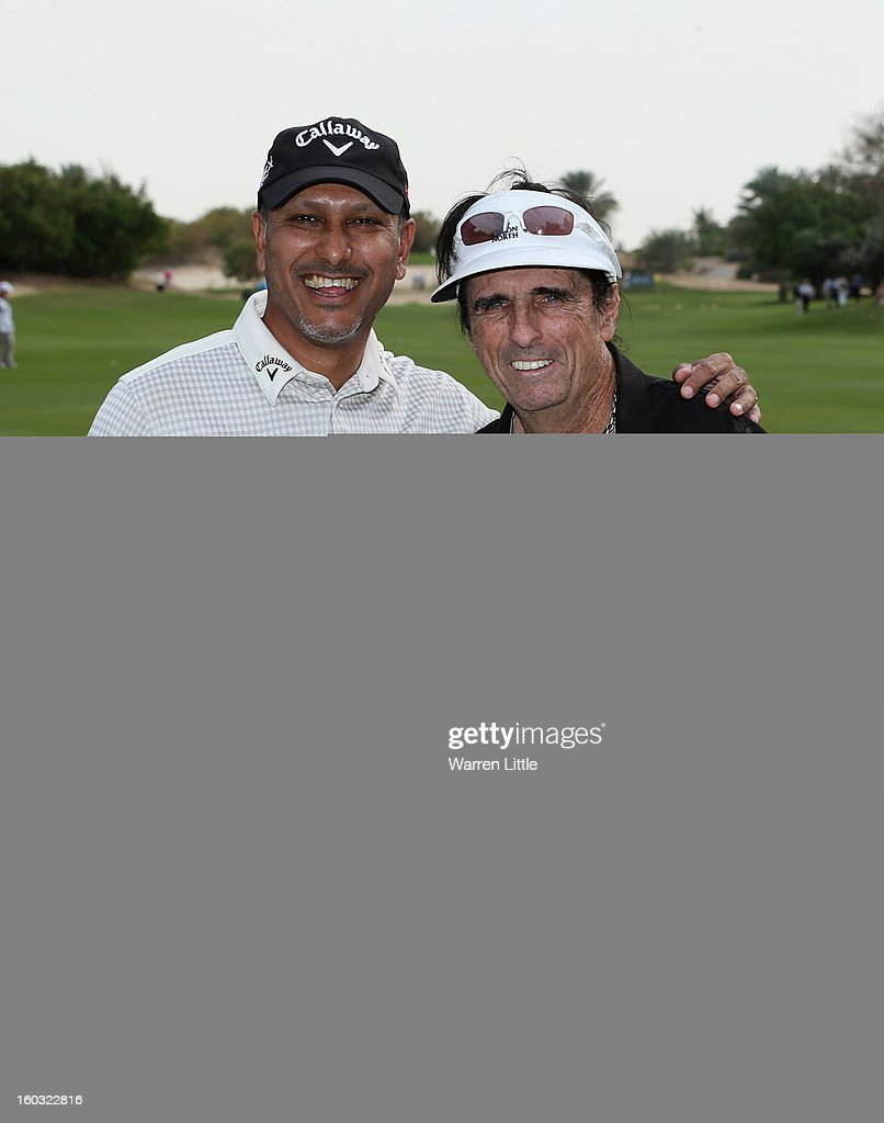 Jeev Milkha Singh of India poses with Rock Star, Alice Cooper in action during a practice round ahead of the Omega Dubai Desert Classic on January 29, 2013 in Dubai, United Arab Emirates.