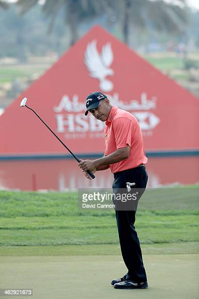 Jeev Milkha Singh of India putting at the par 4 9th hole during the first round of the 2014 Abu Dhabi HSBC Golf Championship at Abu Dhabi Golf Club...