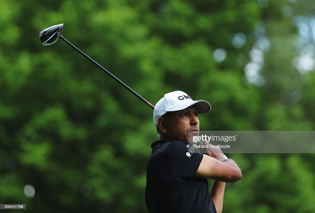 <a gi-track='captionPersonalityLinkClicked' href=/galleries/search?phrase=Jeev+Milkha+Singh&family=editorial&specificpeople=562393 ng-click='$event.stopPropagation()'>Jeev Milkha Singh</a> of India tees off on the 3rd hole during day one of the BMW PGA Championship at Wentworth on May 26, 2016 in Virginia Water, England.