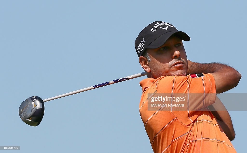 Jeev Milkha Singh of India tees off on the fourth and last round of the Omega Dubai Desert Classic in Dubai, on February 3, 2013. Stephen Gallacher of Scotland fired a timely eagle two on the par-4 16th hole and comfortably won the $2.5 million Omega Dubai Desert Classic in the end by three shots. AFP PHOTO/MARWAN NAAMANI