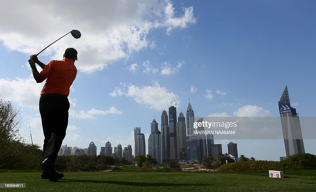 Jeev Milkha Singh of India tees off on the fourth and last round of the Omega Dubai Desert Classic in Dubai, on February 3, 2013. British Robert Rock plays a shot from the bunker on the fouth and last round of the Omega Dubai Desert Classic in Dubai, February 03, 2013.