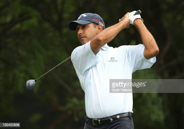 Jeev Milkha Singh of India watches a shot during the Open Championship International Final Qualifying America at the Gleneagles Country Club on May...