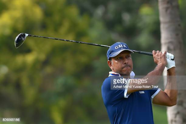 Jeev Singh of IND plays a shot during practice ahead of the TAKE Solutions Masters at Karnataka Golf Association Golf Course on August 2 2017 in...