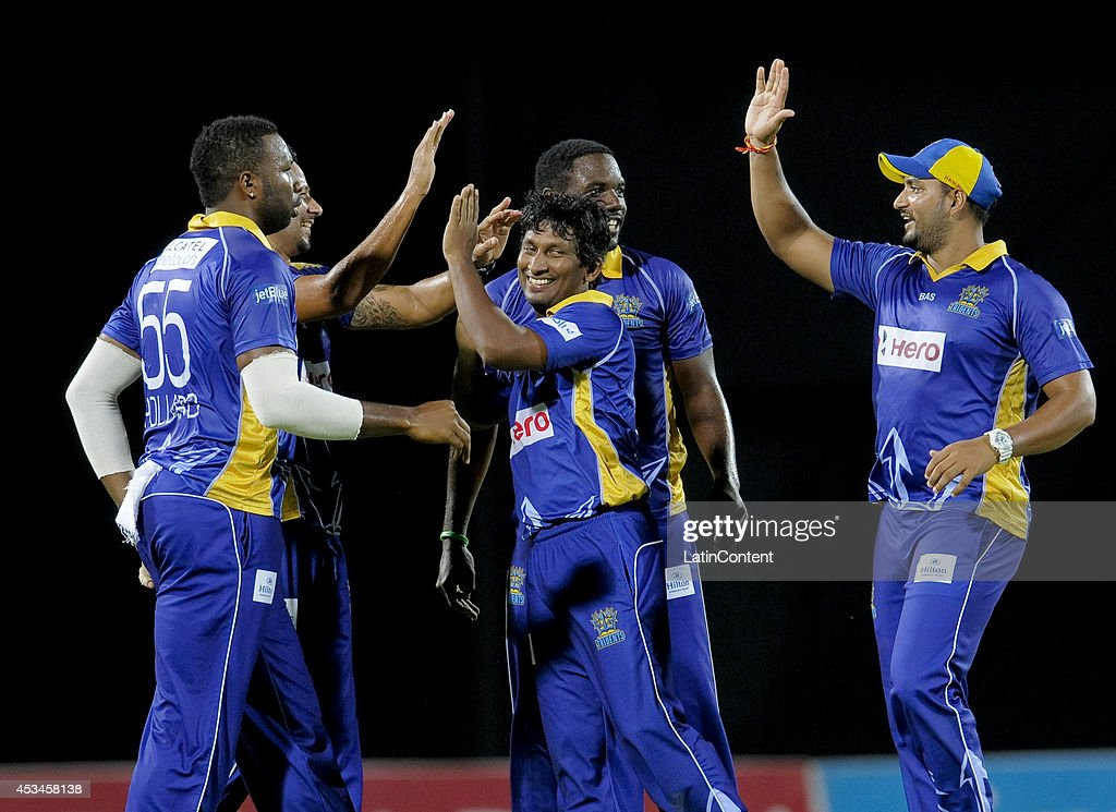 <a gi-track='captionPersonalityLinkClicked' href=/galleries/search?phrase=Jeevan+Mendis&family=editorial&specificpeople=7037737 ng-click='$event.stopPropagation()'>Jeevan Mendis</a> (C) of Barbados Tridents celebrates Owais Alam Shah of Jamaica Tallawahs lbw during a match between Barbados Tridents and Jamaica Tallawahs as part of week 5 of the Caribbean Premier League 2014 at Warner Park on August 10, 2014 in Basseterre, St. Kitts and Nevis.