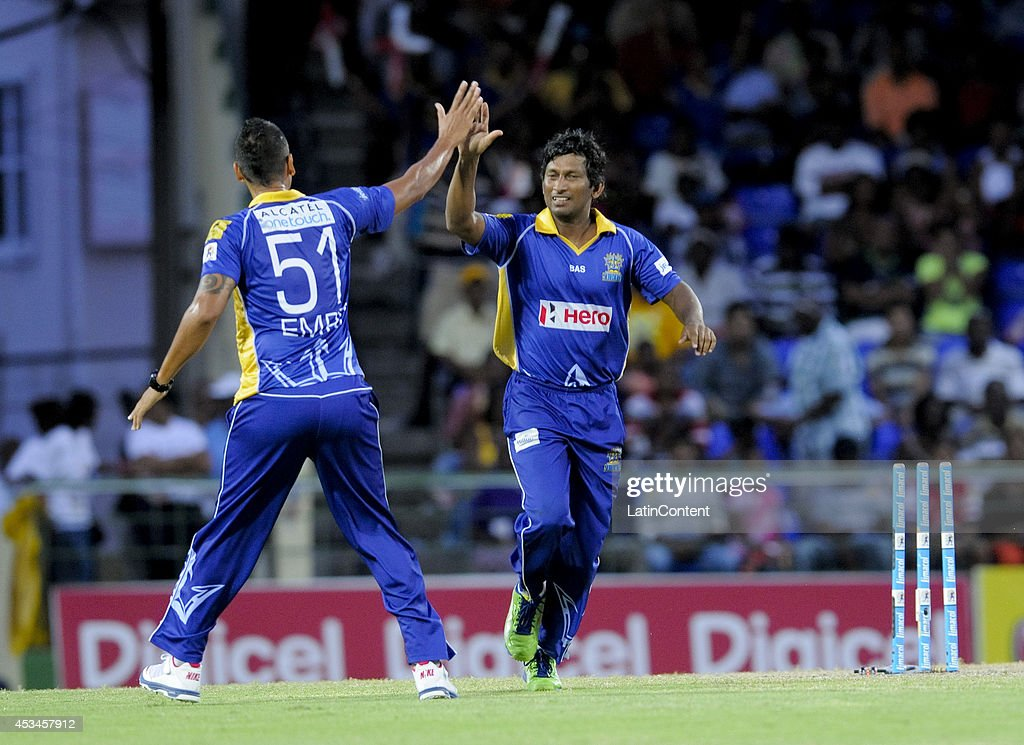 <a gi-track='captionPersonalityLinkClicked' href=/galleries/search?phrase=Jeevan+Mendis&family=editorial&specificpeople=7037737 ng-click='$event.stopPropagation()'>Jeevan Mendis</a> (R) of Barbados Tridents celebrates the dismissal of Adam Voges of Jamaica Tallawahs during a match between Barbados Tridents and Jamaica Tallawahs as part of week 5 of the Caribbean Premier League 2014 at Warner Park on August 10, 2014 in Basseterre, St. Kitts and Nevis.