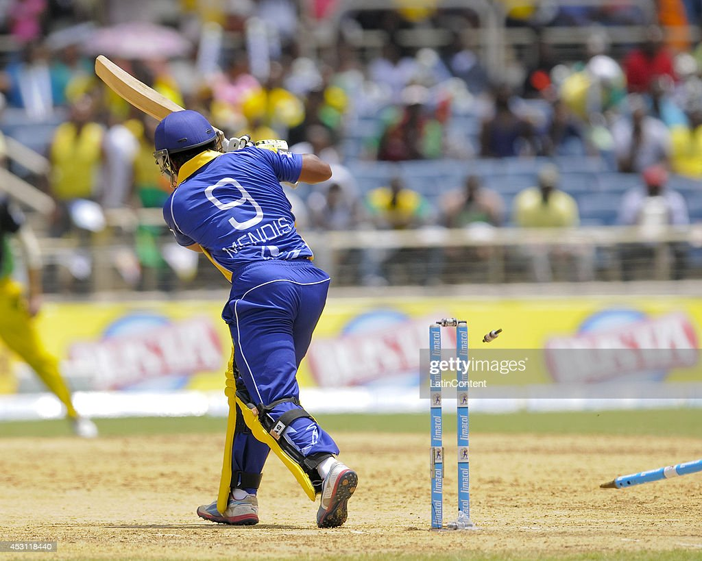 <a gi-track='captionPersonalityLinkClicked' href=/galleries/search?phrase=Jeevan+Mendis&family=editorial&specificpeople=7037737 ng-click='$event.stopPropagation()'>Jeevan Mendis</a> of Barbados Tridents is bowled by Jerome Taylor of Jamaica Tallawahs during a match between Jamaica Tallawahs and Barbados Tridents as part of week 4 of the Caribbean Premier League 2014 at Sabina Park on August 03, 2014 in Kingston, Jamaica.