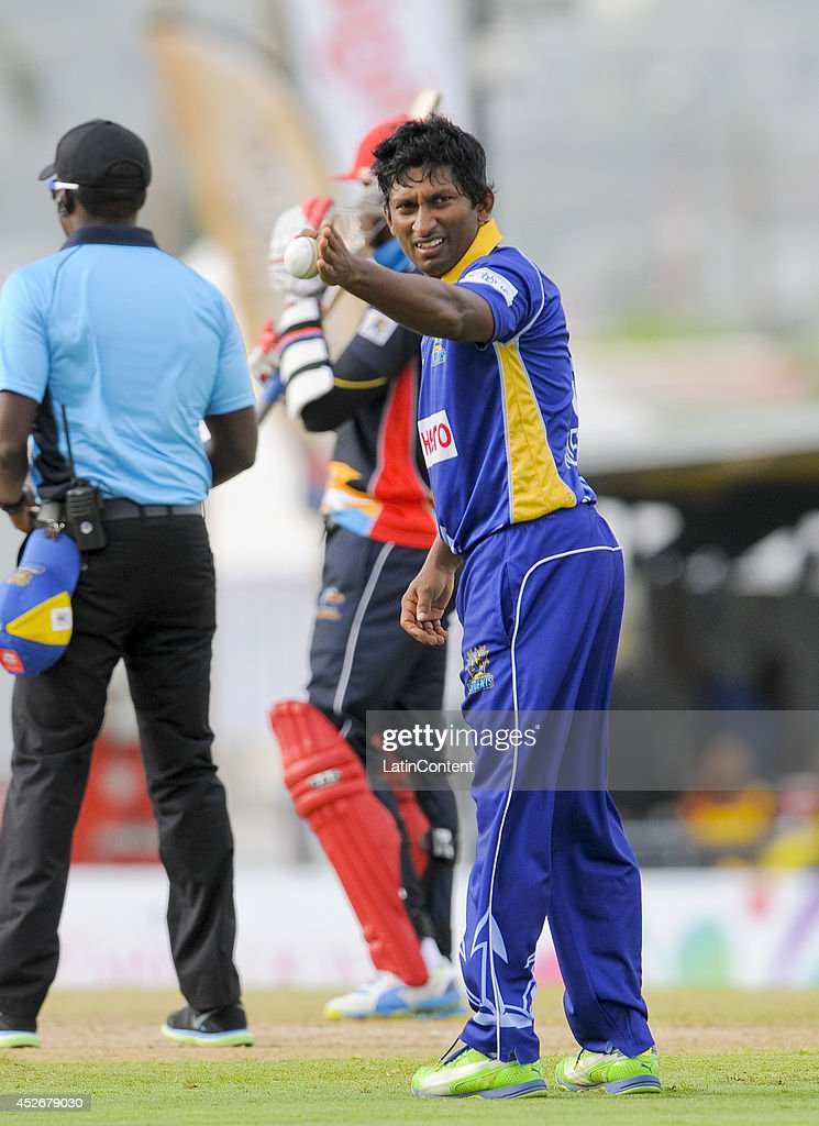<a gi-track='captionPersonalityLinkClicked' href=/galleries/search?phrase=Jeevan+Mendis&family=editorial&specificpeople=7037737 ng-click='$event.stopPropagation()'>Jeevan Mendis</a> (R) of Barbados Tridents sets the field during a match between Barbados Tridents and Antigua Hawksbills as part of the week 3 of Caribbean Premier League 2014 at Kensington Oval on July 25, 2014 in Bridgetown, Barbados.