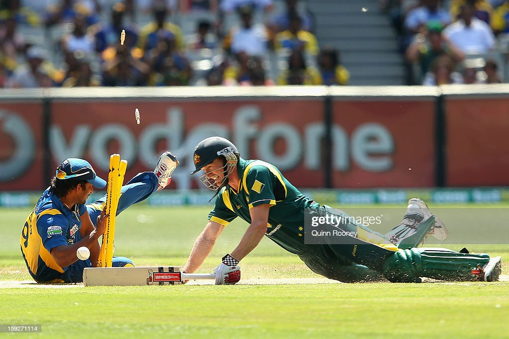 Jeevan Mendis of Sri Lanka attempts to run out George Bailey of Australia during game one of the Commonwealth Bank One Day International series between Australia and Sri Lanka at the Melbourne Cricket Ground on January 11, 2013 in Melbourne, Australia.