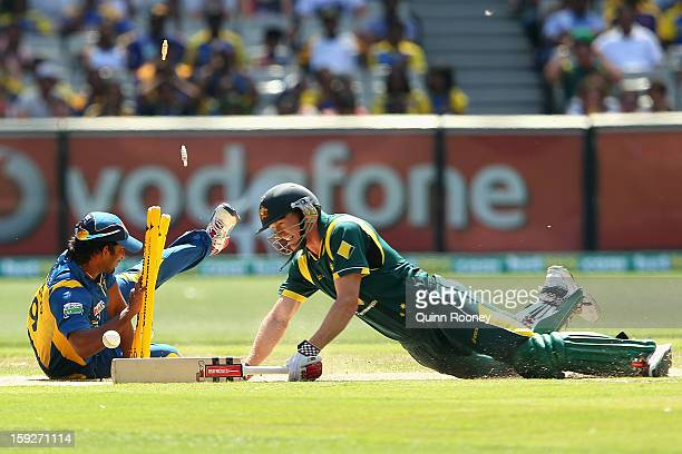 Jeevan Mendis of Sri Lanka attempts to run out George Bailey of Australia during game one of the Commonwealth Bank One Day International series...