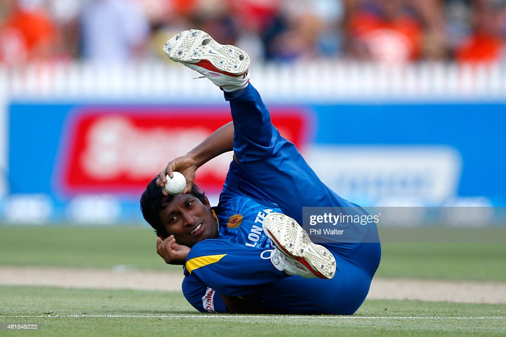 <a gi-track='captionPersonalityLinkClicked' href=/galleries/search?phrase=Jeevan+Mendis&family=editorial&specificpeople=7037737 ng-click='$event.stopPropagation()'>Jeevan Mendis</a> of Sri Lanka catches out Brendon McCullum of New Zealand during the One Day International match between New Zealand and Sri Lanka at Seddon Park on January 15, 2015 in Hamilton, New Zealand.