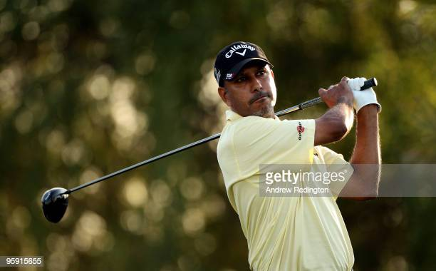 JeevMilka Singh of India hits his teeshot on the ninhth hole during the first round of The Abu Dhabi Golf Championship at Abu Dhabi Golf Club on...