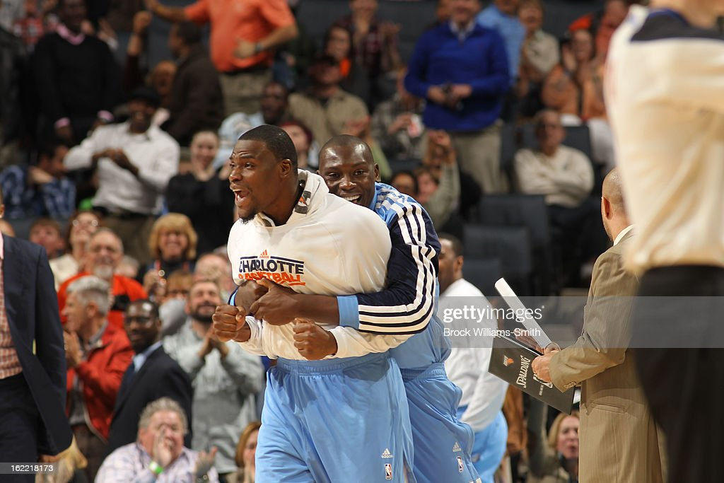 Jeff Adrien #4 and Bismack Biyombo #0 of the Charlotte Bobcats celebrate during the game against the Detroit Pistons at the Time Warner Cable Arena on February 20, 2013 in Charlotte, North Carolina.