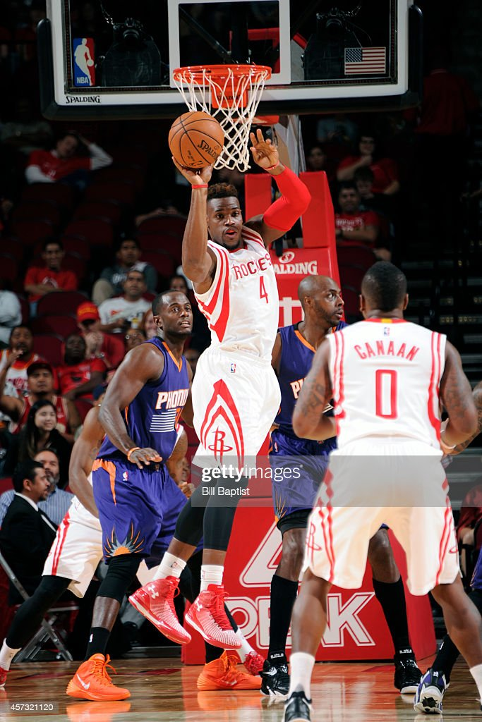 <a gi-track='captionPersonalityLinkClicked' href=/galleries/search?phrase=Jeff+Adrien&family=editorial&specificpeople=727235 ng-click='$event.stopPropagation()'>Jeff Adrien</a> #4 of of the Houston Rockets looks to pass against the Phoenix Suns on October 13, 2014 at the Toyota Center in Houston, Texas.