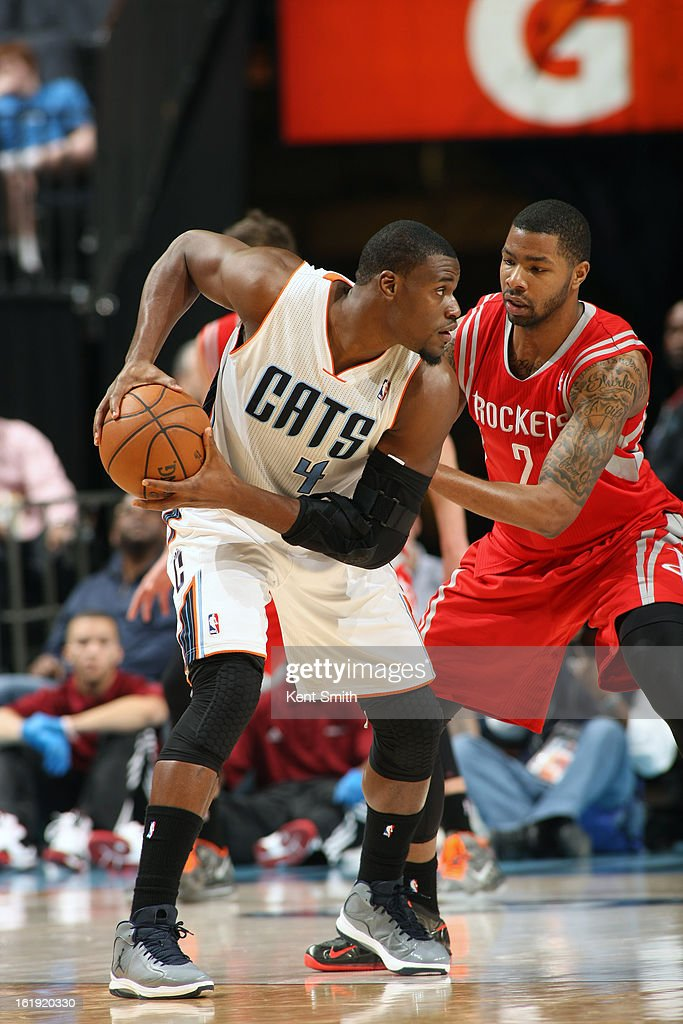 <a gi-track='captionPersonalityLinkClicked' href=/galleries/search?phrase=Jeff+Adrien&family=editorial&specificpeople=727235 ng-click='$event.stopPropagation()'>Jeff Adrien</a> #4 of the Charlotte Bobcats controls the ball against Marcus Morris #2 of the Houston Rockets at the Time Warner Cable Arena on January 21, 2013 in Charlotte, North Carolina.