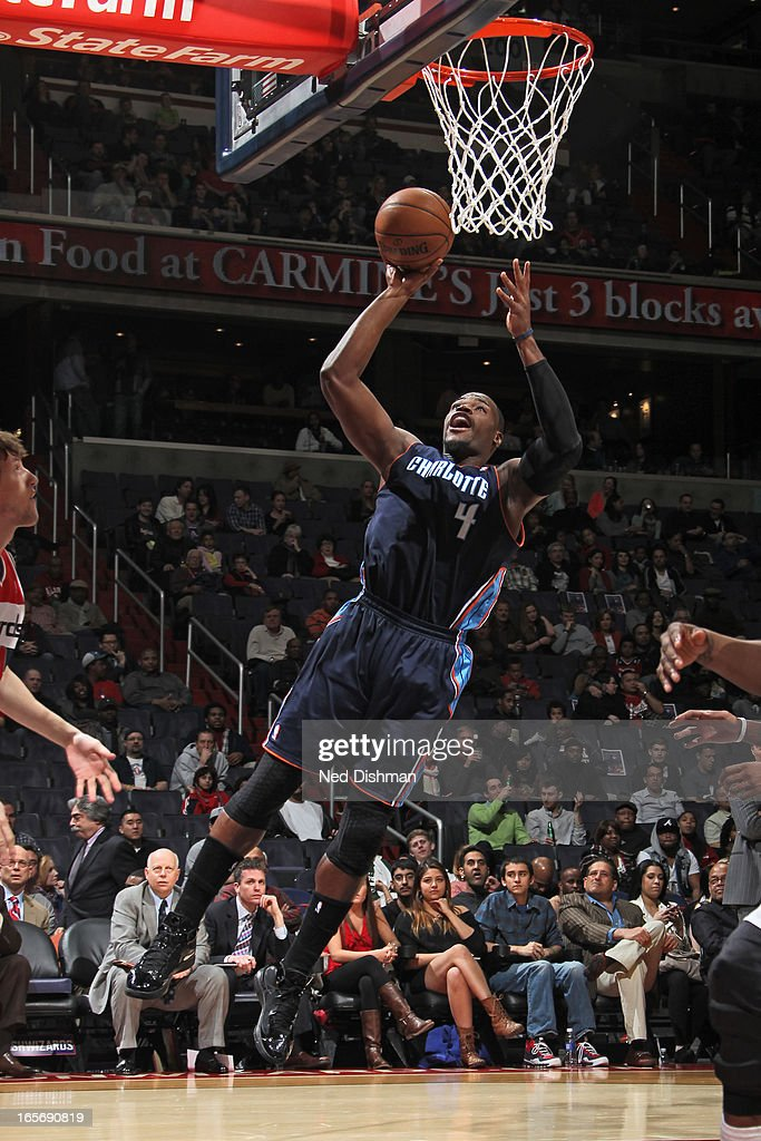 Jeff Adrien #4 of the Charlotte Bobcats drives to the basket against the Washington Wizards at the Verizon Center on March 9, 2013 in Washington, DC.