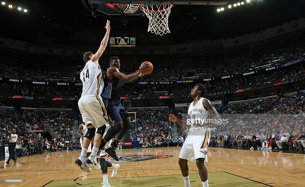 <a gi-track='captionPersonalityLinkClicked' href=/galleries/search?phrase=Jeff+Adrien&family=editorial&specificpeople=727235 ng-click='$event.stopPropagation()'>Jeff Adrien</a> #4 of the Charlotte Bobcats goes to the basket against Jason Smith #14 of the New Orleans Pelicans on November 2, 2013 at the New Orleans Arena in New Orleans, Louisiana.