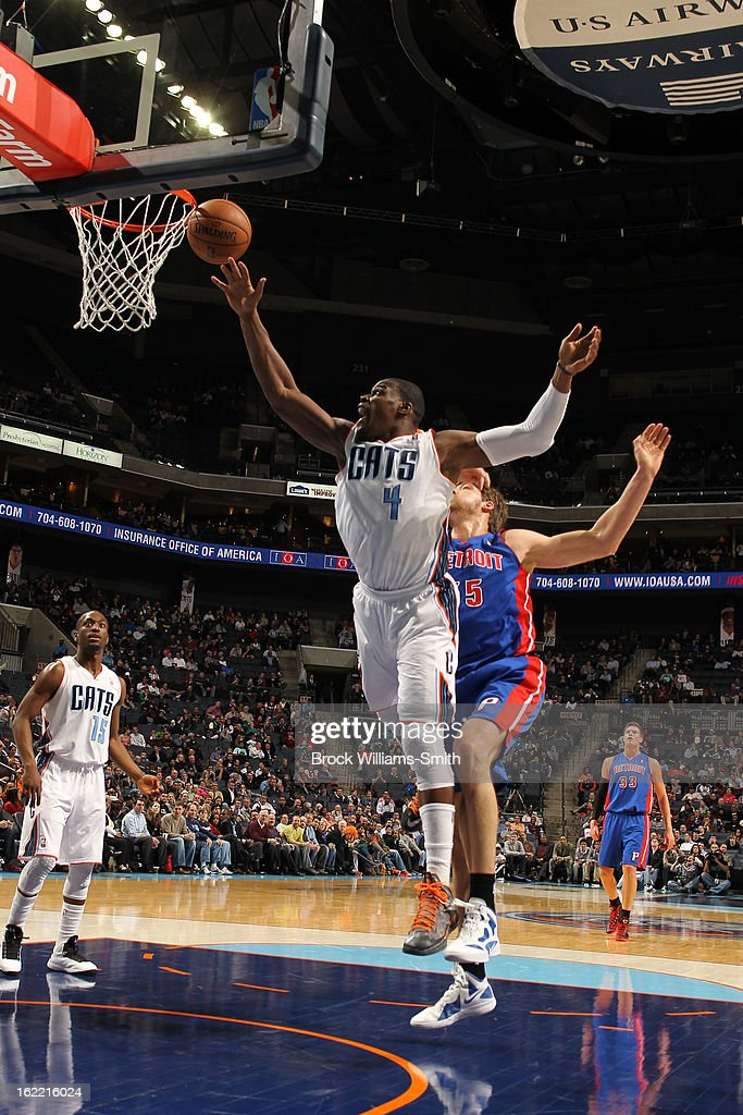 Jeff Adrien #4 of the Charlotte Bobcats goes up for a rebound against Viacheslav Kravtsov #55 of the Detroit Pistons at the Time Warner Cable Arena on February 20, 2013 in Charlotte, North Carolina.
