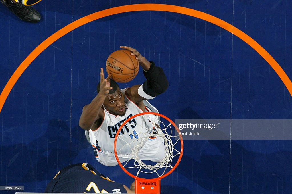 <a gi-track='captionPersonalityLinkClicked' href=/galleries/search?phrase=Jeff+Adrien&family=editorial&specificpeople=727235 ng-click='$event.stopPropagation()'>Jeff Adrien</a> #4 of the Charlotte Bobcats grabs a rebound against the Indiana Pacers at the Time Warner Cable Arena on January 15, 2013 in Charlotte, North Carolina.
