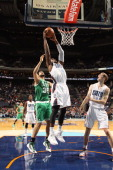 Jeff Adrien of the Charlotte Bobcats grabs the rebound against Vitor Faverani of the Boston Celtics during the game at the Time Warner Cable Arena on...