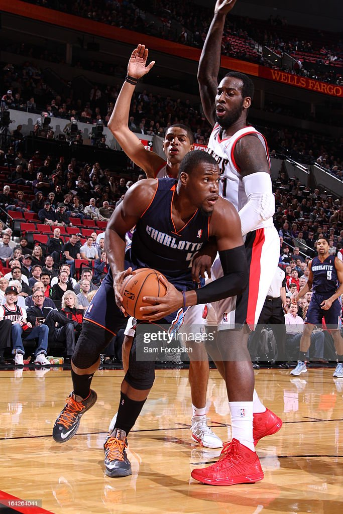 Jeff Adrien #4 of the Charlotte Bobcats looks to pass the ball against J.J. Hickson #21 of the Portland Trail Blazers on March 4, 2013 at the Rose Garden Arena in Portland, Oregon.