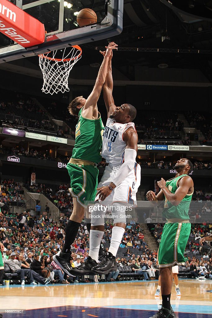<a gi-track='captionPersonalityLinkClicked' href=/galleries/search?phrase=Jeff+Adrien&family=editorial&specificpeople=727235 ng-click='$event.stopPropagation()'>Jeff Adrien</a> #4 of the Charlotte Bobcats puts up the close shot against the Boston Celtics at the Time Warner Cable Arena on March 12, 2013 in Charlotte, North Carolina.
