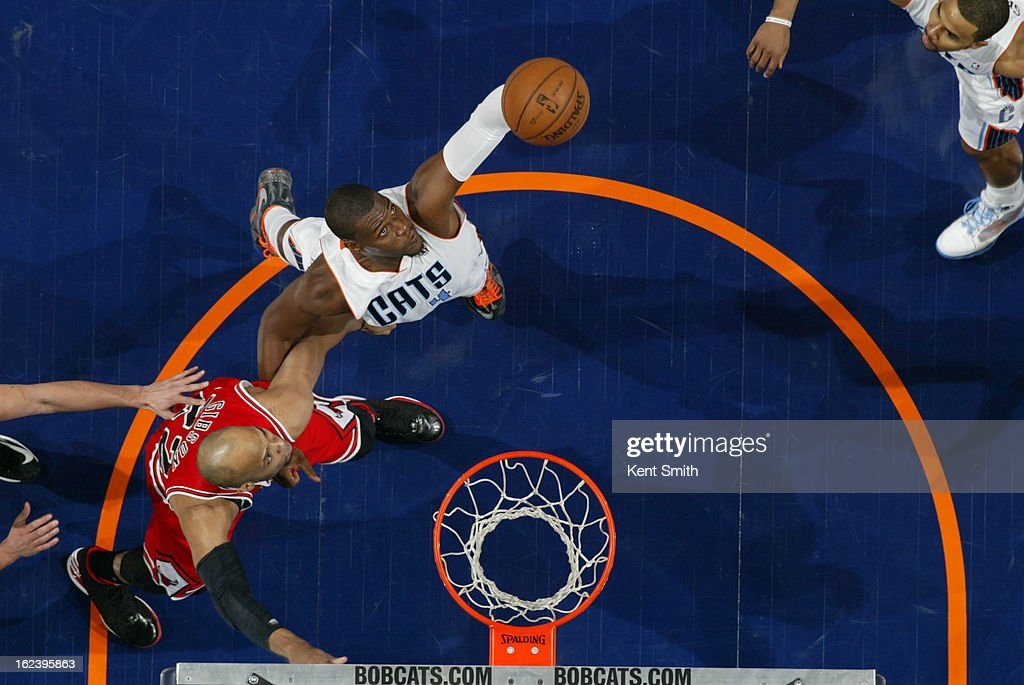 <a gi-track='captionPersonalityLinkClicked' href=/galleries/search?phrase=Jeff+Adrien&family=editorial&specificpeople=727235 ng-click='$event.stopPropagation()'>Jeff Adrien</a> #4 of the Charlotte Bobcats rebounds <a gi-track='captionPersonalityLinkClicked' href=/galleries/search?phrase=Taj+Gibson&family=editorial&specificpeople=4029461 ng-click='$event.stopPropagation()'>Taj Gibson</a> #22 of the Chicago Bulls at the Time Warner Cable Arena on February 22, 2013 in Charlotte, North Carolina.