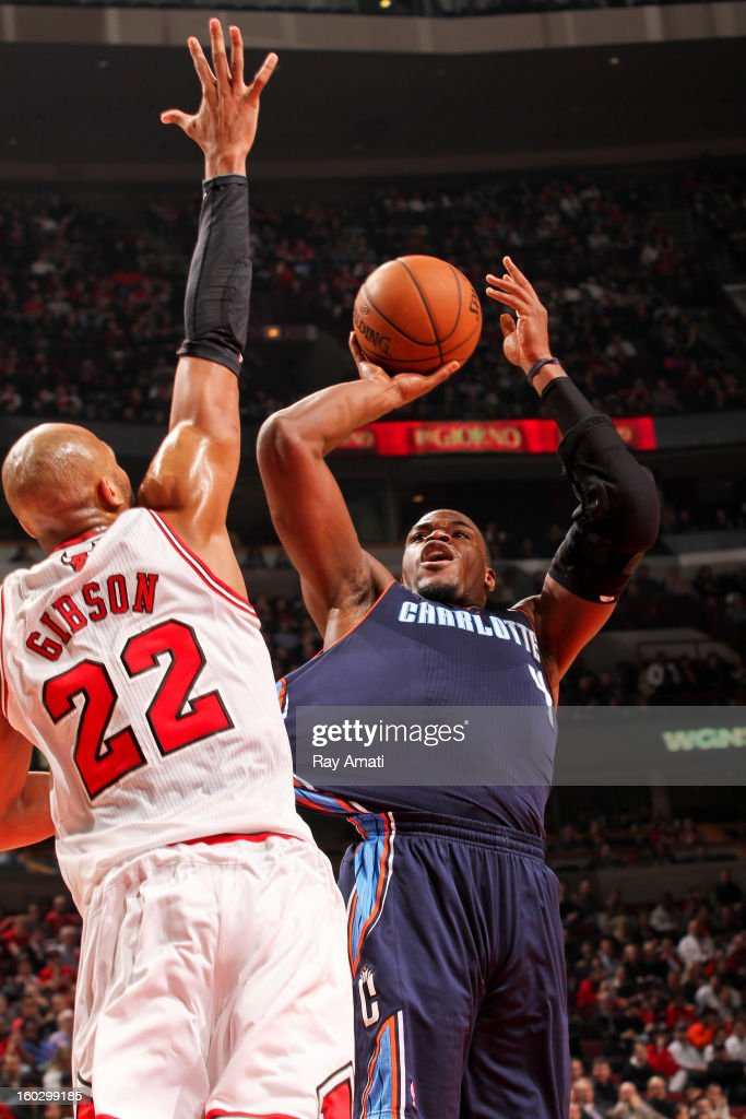 Jeff Adrien #4 of the Charlotte Bobcats shoots against Taj Gibson #22 of the Chicago Bulls on January 28, 2013 at the United Center in Chicago, Illinois.