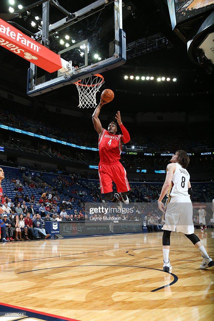 <a gi-track='captionPersonalityLinkClicked' href=/galleries/search?phrase=Jeff+Adrien&family=editorial&specificpeople=727235 ng-click='$event.stopPropagation()'>Jeff Adrien</a> #4 of the Houston Rockets goes up for the dunk against the New Orleans Pelicans at the Smoothie King Center on October 14, 2014 in New Orleans, Louisiana.