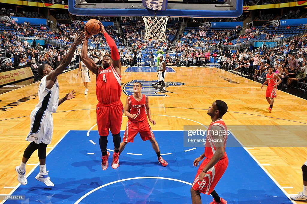 <a gi-track='captionPersonalityLinkClicked' href=/galleries/search?phrase=Jeff+Adrien&family=editorial&specificpeople=727235 ng-click='$event.stopPropagation()'>Jeff Adrien</a> #4 of the Houston Rockets grabs a rebound against the Orlando Magic on October 22, 2014 at Amway Center in Orlando, Florida.