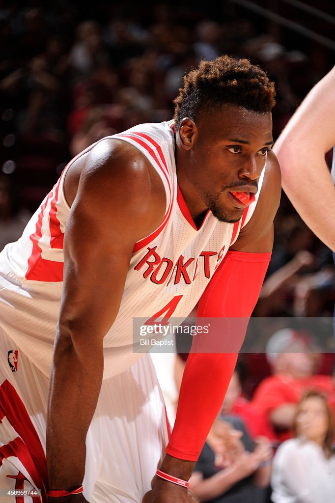 <a gi-track='captionPersonalityLinkClicked' href=/galleries/search?phrase=Jeff+Adrien&family=editorial&specificpeople=727235 ng-click='$event.stopPropagation()'>Jeff Adrien</a> #4 of the Houston Rockets prepares to box out during the game against the Memphis Grizzlies on October 9, 2014 at the Toyota Center in Houston, Texas.