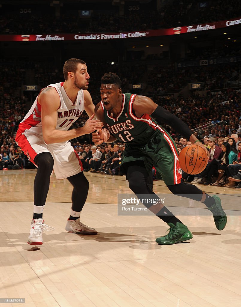 <a gi-track='captionPersonalityLinkClicked' href=/galleries/search?phrase=Jeff+Adrien&family=editorial&specificpeople=727235 ng-click='$event.stopPropagation()'>Jeff Adrien</a> #12 of the Milwaukee Bucks drives to the basket against <a gi-track='captionPersonalityLinkClicked' href=/galleries/search?phrase=Jonas+Valanciunas&family=editorial&specificpeople=5654195 ng-click='$event.stopPropagation()'>Jonas Valanciunas</a> #17 of the Toronto Raptors on April 14, 2014 at the Air Canada Centre in Toronto, Ontario, Canada.