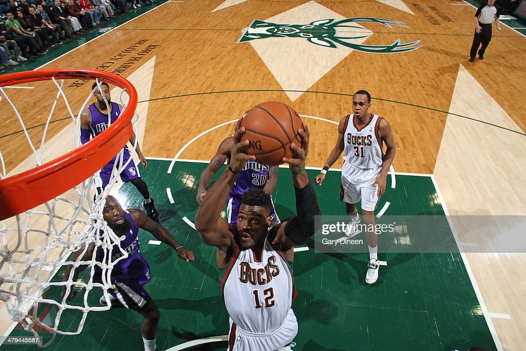Jeff Adrien #12 of the Milwaukee Bucks goes up for a shot against the Sacramento Kings on March 5, 2014 at the BMO Harris Bradley Center in Milwaukee, Wisconsin.
