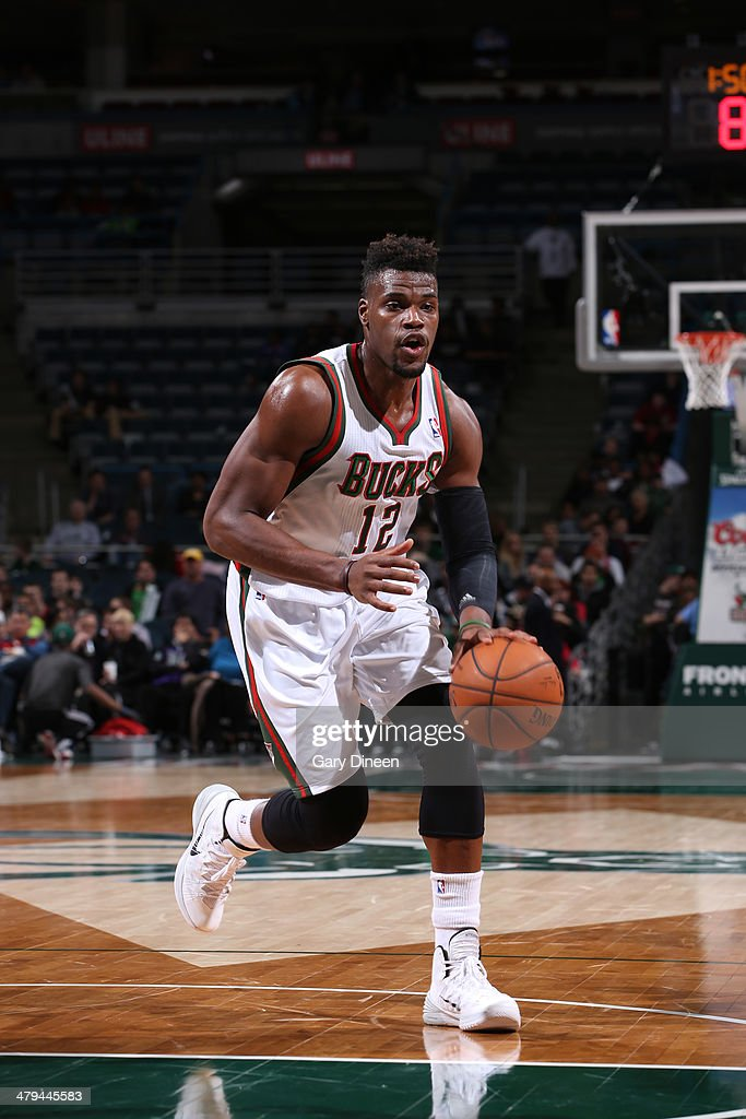 <a gi-track='captionPersonalityLinkClicked' href=/galleries/search?phrase=Jeff+Adrien&family=editorial&specificpeople=727235 ng-click='$event.stopPropagation()'>Jeff Adrien</a> #12 of the Milwaukee Bucks handles the ball against the Sacramento Kings on March 5, 2014 at the BMO Harris Bradley Center in Milwaukee, Wisconsin.