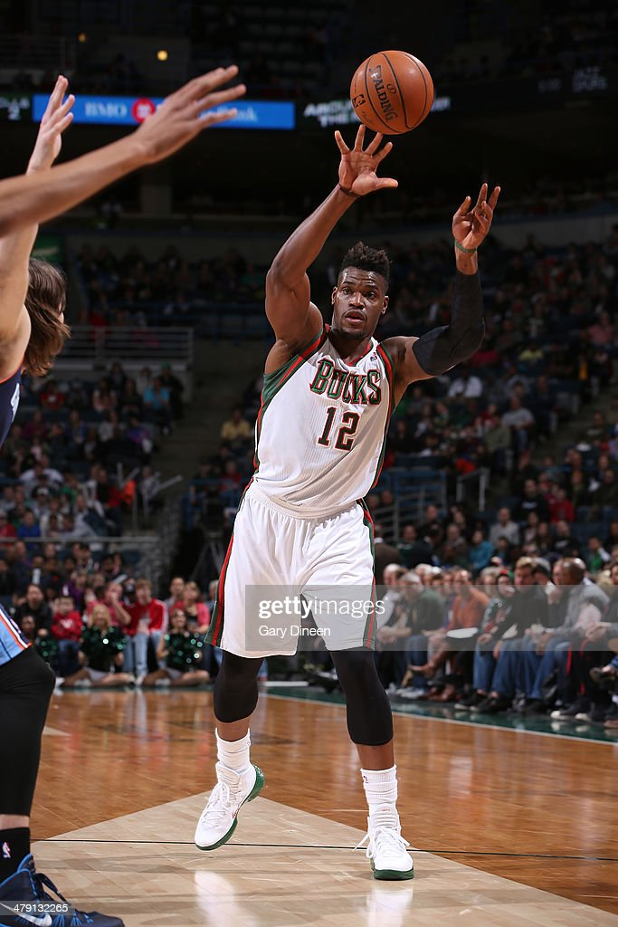 <a gi-track='captionPersonalityLinkClicked' href=/galleries/search?phrase=Jeff+Adrien&family=editorial&specificpeople=727235 ng-click='$event.stopPropagation()'>Jeff Adrien</a> #12 of the Milwaukee Bucks passes against Josh McRoberts #11 of the Charlotte Bobcats on March 16, 2014 at the BMO Harris Bradley Center in Milwaukee, Wisconsin.