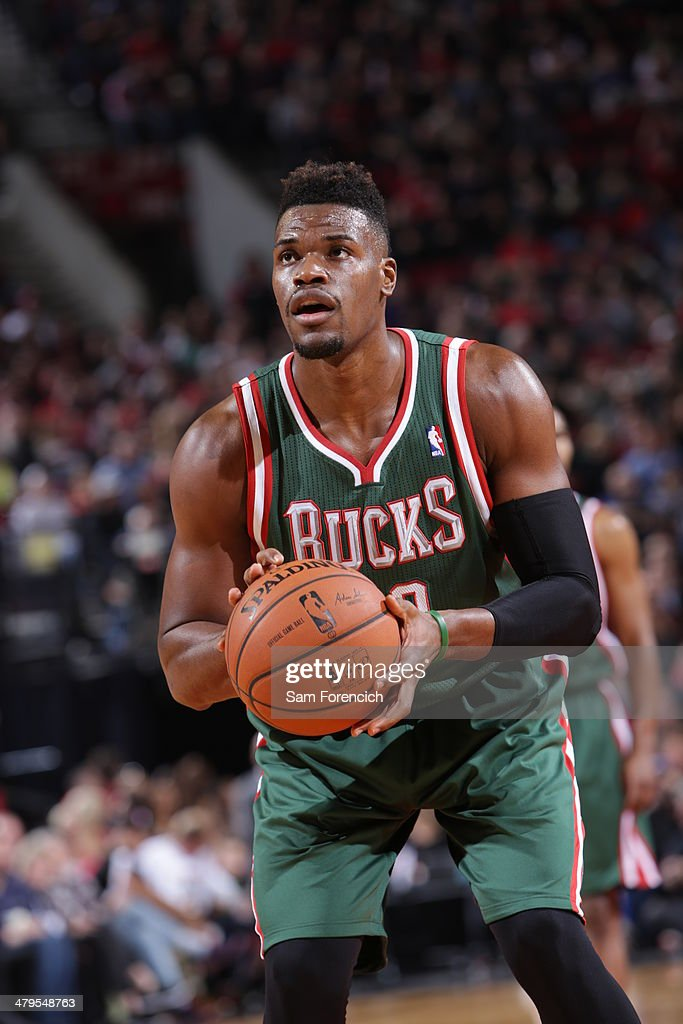 <a gi-track='captionPersonalityLinkClicked' href=/galleries/search?phrase=Jeff+Adrien&family=editorial&specificpeople=727235 ng-click='$event.stopPropagation()'>Jeff Adrien</a> #12 of the Milwaukee Bucks shoots a foul shot against the Portland Trail Blazers on March 18, 2014 at the Moda Center Arena in Portland, Oregon.