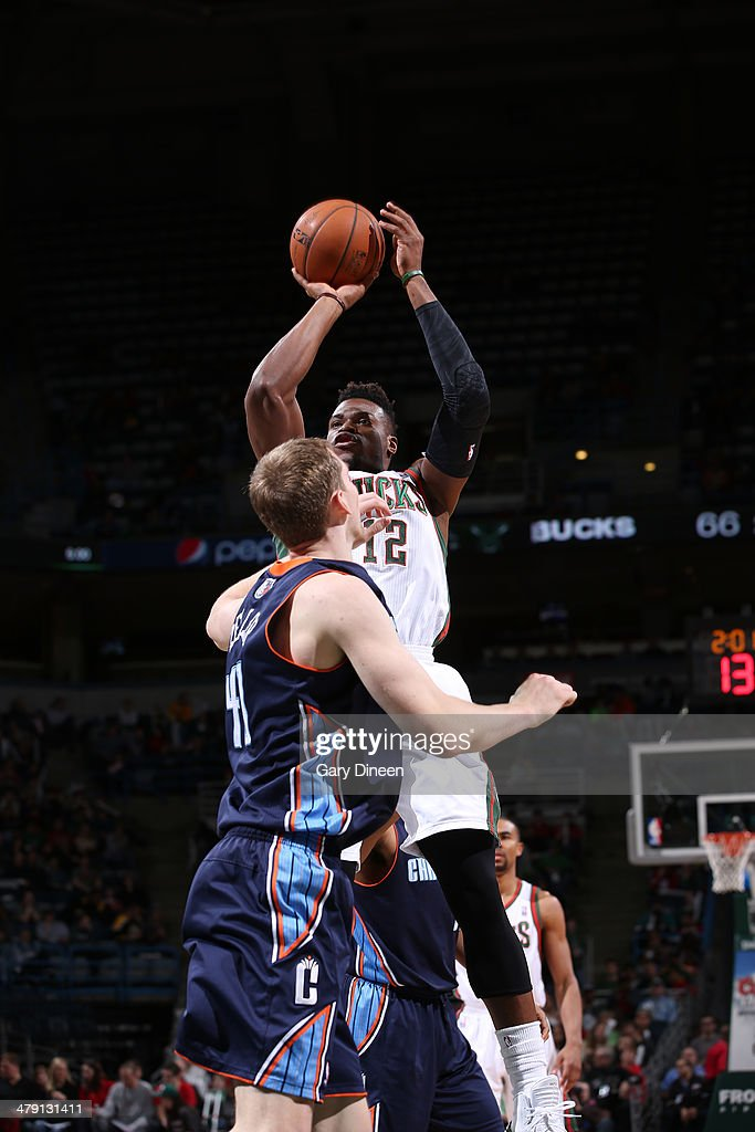 <a gi-track='captionPersonalityLinkClicked' href=/galleries/search?phrase=Jeff+Adrien&family=editorial&specificpeople=727235 ng-click='$event.stopPropagation()'>Jeff Adrien</a> #12 of the Milwaukee Bucks shoots against Cody Zeller #40 of the Charlotte Bobcats on March 16, 2014 at the BMO Harris Bradley Center in Milwaukee, Wisconsin.