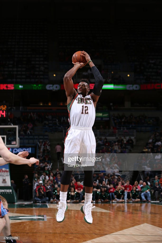<a gi-track='captionPersonalityLinkClicked' href=/galleries/search?phrase=Jeff+Adrien&family=editorial&specificpeople=727235 ng-click='$event.stopPropagation()'>Jeff Adrien</a> #12 of the Milwaukee Bucks shoots against the Charlotte Bobcats on March 16, 2014 at the BMO Harris Bradley Center in Milwaukee, Wisconsin.